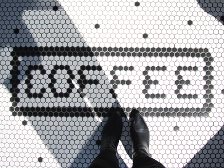 Floor tiles that spell Coffee